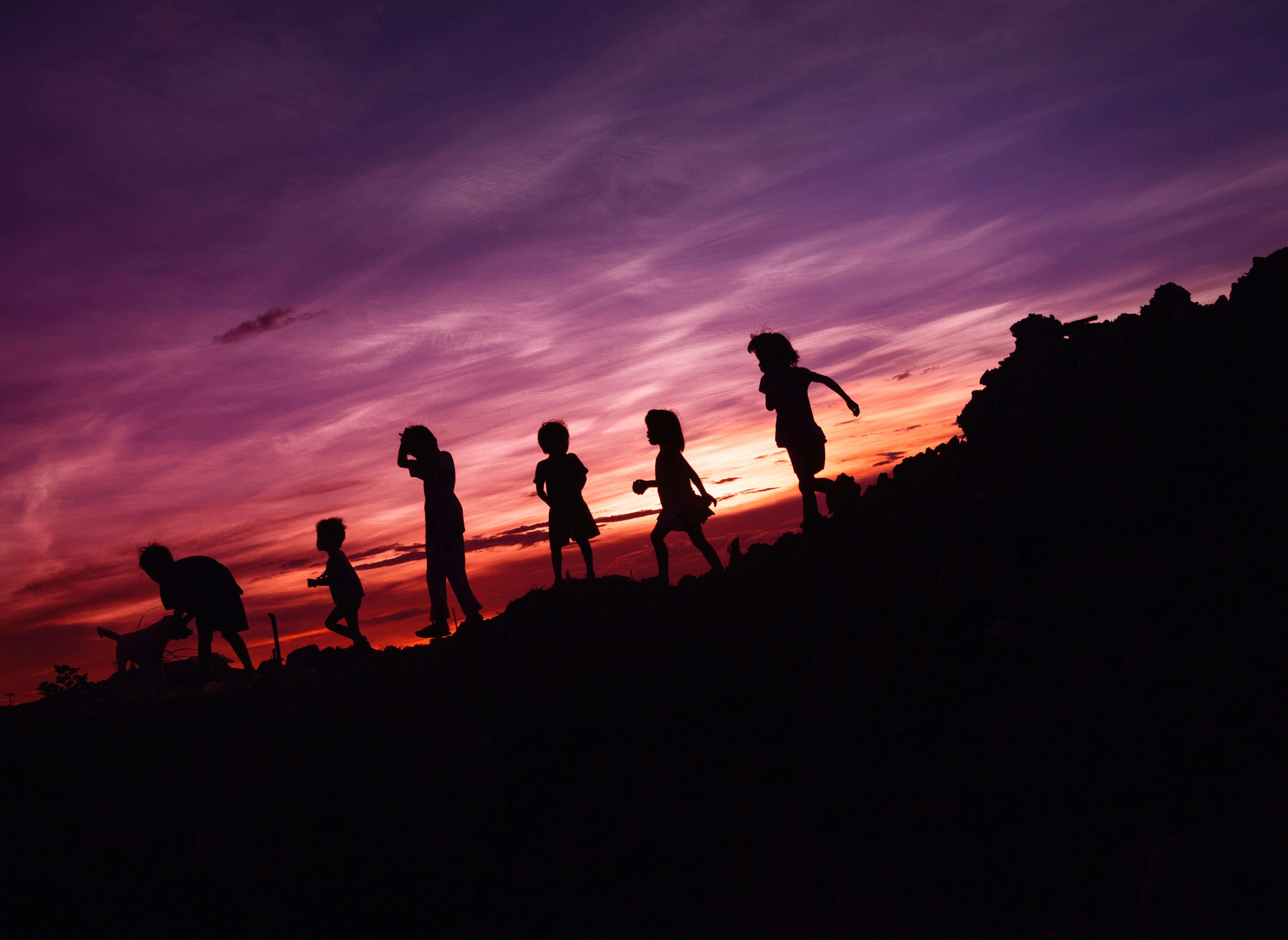 Heroes and Genius... children silhouetted against a colourful sunset